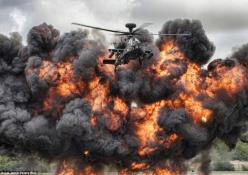 Fireball: Corporal Jamie Peters won Best Overall Image for 'Fireball Flyers', which shows an Army Air Corp Apache from the display team wowing crowds at the Royal International Air Tattoo. The display uses pyrotechnics to simulate some of the fire