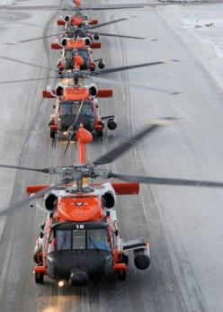 KODIAK, Alaska - The four MH-60 Jayhawk rescue helicopters attached to Air Station Kodiak taxi down the Coast Guard base taxiway in preparation for a formation flight Wednesday, Dec. 2, 2009, in 17 mph winds with snow squalls and temperatures in the 30s.