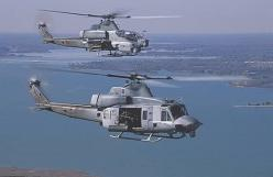 USMC UH-1Y & AH-1Z. Enter the H-1 program, the USMC's plan to remanufacture older helicopters into new and improved UH-1Y utility and AH-1Z attack helicopters. The new versions would discard the signature 2-bladed rotors for modern 4-bladed improvemen