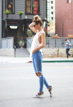 Loose Fitting White Tank Top with Slits on Sides, Bikini Top, Light Blue Jeans Ripped at the Knee, Plaid Slip-On Sneakers, Sunglasses and High Bun. #city #fashion: Outfits, Ripped Jeans, Fashion, Clothes, Street Style, Spring Summer, Casual, Styles