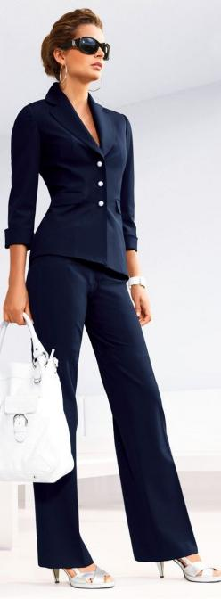 Find a suit that is right for your figure and have it tailored to perfection. Make sure to wear the same shoes you will wear with it to get the right hem. Blue is an nice change from the over done black. A neat up do and sunglasses will ensure you look co