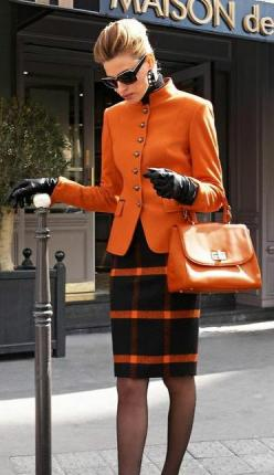 Shop this look for $372: http://lookastic.com/women/looks/sunglasses-and-coat-and-gloves-and-satchel-bag-and-pencil-skirt-and-tights-and-turtleneck/3967 — Black Sunglasses — Orange Coat — Black Leather Gloves — Orange Leather Satchel Bag — Black Plaid Woo