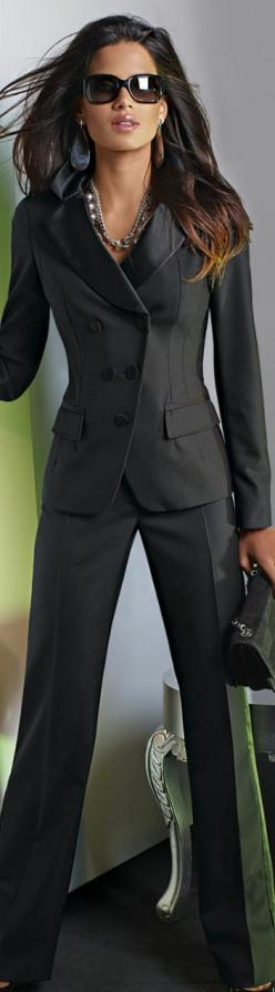 Now this is a power suit! Sophisticated and a bit sexy, charcoal gray/espressro suit with clean lines.  Larger accessories add a little spice.  More conservative look would include smaller earrings (hoops or even pearls) Wear with neutral shoes.  #suits #