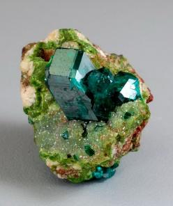 Dioptase on Duftite and Calcite: from the Tsumeb Mine, Otjikoto Region, Tsumeb, Namibia. A grass green matrix of duftite and calcite is host to a 12 mm tall dioptase crystal.: Crystals, Gemstones, Emerald, Rocks, Minerals