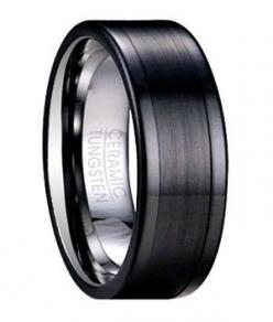 Exuding a quiet masculine power, this men's tungsten ceramic ring is undeniably impressive. Subtle mixed finishes define this 8mm comfort fit black band. A contemporary flat profile further accentuates the slight contrast between the brushed finish center