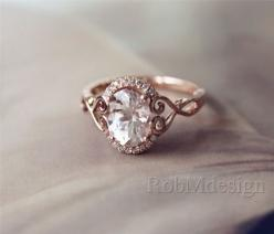 In loooove with this ring. Would want the center stone to be (natural) light blue topaz, though.: Morganite Engagement Ring, Rose Gold Engagement Ring, Rose Gold Wedding Ring, Halo Wedding Ring, Unique Vintage Wedding Ring, Antique Wedding Ring, Unique We