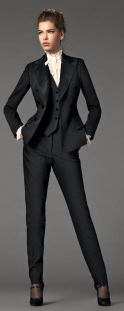Dolce Gabbana , I am totally loving the dressing like a man look, its totally sexy w/ the ruffles and heelsa, wonder if my husband will like this look as much as I do this year, Totally think I can pull this off...hmmm we shall c Cool websites where to bu