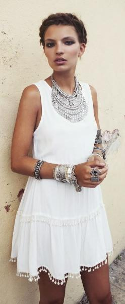 Fashion trends | White boho dress with braid crown and oversized silver accessories