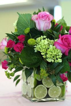 Love the limes in the water! green and pink flower arrangement ♥: Pink Flower, Table Centerpiece, Table Setting, Pink Rose, Floral Arrangement, Center Piece