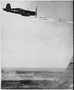 43-0038a  A Corsair unloads its rockets on a Japanese position during the battle for Okinawa, June 1945.
