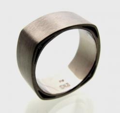 A wedding ring like this maybe. Soft Square with Voids Wedding Band by lrjewelry on Etsy