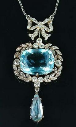 An Edwardian aquamarine and diamond pendant, circa 1910