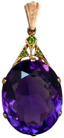 Art Deco Siberian Amethyst Pendant c. 1930.     An Art Deco Siberian Amethyst, Demantoid Garnet and Rose Gold Pendant.    The pendant features an oval cut large Siberian amethyst with an approximate weight of 30,5 carats.     The Art Deco gold mount is se