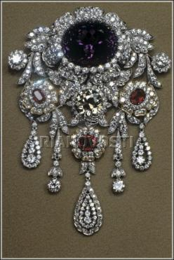 Brooch of Diamond Fund, Platinum and Gold. Diamonds (36.01 ct) Rubies (4.57 ct.) Amethyst (8.38 ct.) Moscow, Russia. 1993