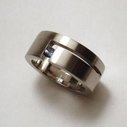 I really love my wedding band, but I could consider wearing this one on my other hand. It's freaking neat!