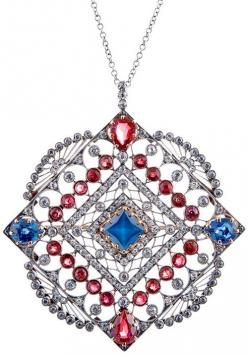 Large Edwardian Ruby, Diamond and Sapphire Pendant, circa 1910. Measuring a substantial 2 inches tall (with the modest bale) and 1.75 inches wide, this beautiful rendition of vintage Americana boasts 3 carats of rubies, 2.22 carats of sapphires and 2 cara