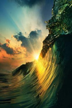 Love how the sun rays are going through the wave amazing combination of colors ! Really truly quite beautiful scene!