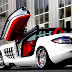 Mercedes Benz SLR McLaren Roadster White with a cherry red interior! Gorgeous! Price: $495,000. (INR 2,37,60,000)  The SLR McLaren is the fastest automatic transmission car in the world. It is a luxurious convertible with a really powerful engine and outs