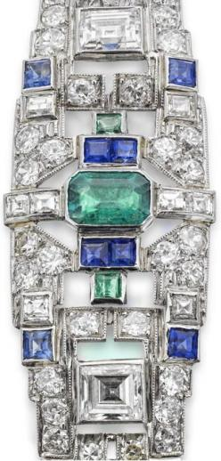 An Art Deco gem-set bracelet, circa 1930. The tapered frontispiece set with an octagonal-cut emerald between a pair of baguette-cut diamonds, in turn between a pair of oval-cut sapphires, all to a geometric framework set throughout with carré-cut sapphire