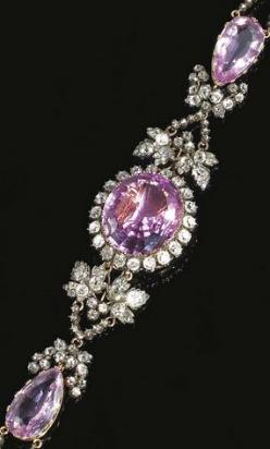 PINK TOPAZ AND DIAMOND BRACELET, CIRCA 1830  The central oval pink topaz set within a border of old-mine diamonds, on an articulated bracelet set with two pear-shaped pink topaz, interspersed with vine leaf motifs set with circular- and rose-cut diamonds,