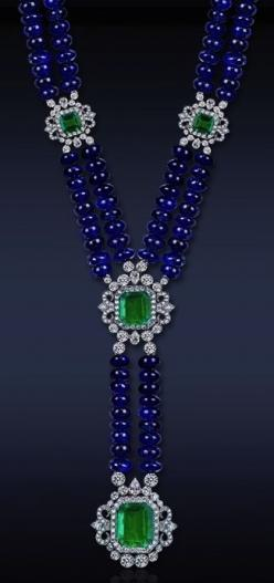 Sapphire bead necklace with emeralds and diamonds set in platinum.