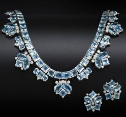 The articulated row of square-cut aquamarines suspending alternating trios and chevrons of vari-cut aquamarines and brilliant-cut diamonds, to a foxtail-link backchain, together with a pair of earclips en suite, diamonds approximately 2.10 carats total, s