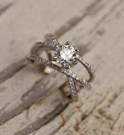 How gorgeous is this platinum diamond engagement ring by Marco Gutierrez? The delicate details are unique and elegant.