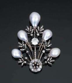 A Belle Epoque Pearl and Diamond Brooch by Chaumet Designed as an openwork spray with five drop-shaped pearl terminals and old-cut diamond-set leaves with a diamond collet to the central stem, circa 1890, mounted in silver and gold, one small diamond defi