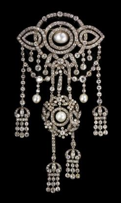 A Belle Epoque Silver Topped Gold, Diamond and Natural Pearl Corsage Ornament, Cartier, Circa 1898, contains 479 old mine and rose cut diamonds and measures approx 143.00 x 73.00 mm, includes removable brooch fitting, and a black velvet choker containing