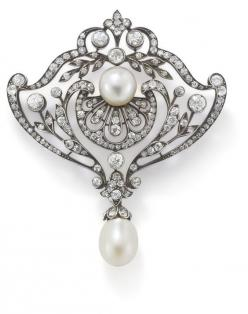 An antique natural pearl and diamond brooch  In the garland style, the central natural pearl surmounting a palmette motif set with single- and Swiss-cut diamonds amidst similarly set scrolling foliate border, terminating in natural pearl drop and diamond-
