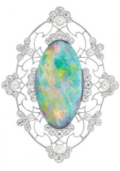 Edwardian Platinum, Black Opal, Diamond and Pearl Brooch. Centring one oval opal approximately 14.75 cts., within a pierced openwork frame of floral motif, set with 8 seed pearls and 42 small old European-cut and single-cut diamonds, circa 1910.