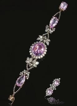 RARE PINK! TOPAZ AND DIAMOND BRACELET, CIRCA 1830. The central oval pink topaz set within a border of old-mine diamonds, on an articulated bracelet set with two pear-shaped pink topaz, interspersed with vine leaf motifs set with circular- and rose-cut dia