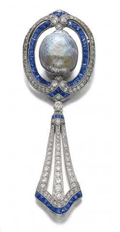 SAPPHIRE, DIAMOND AND CULTURED PEARL BROOCH, CIRCA 1910 WITH LATER MODIFICATION. The brooch centring on a baroque cultured pearl of iridescent aubergine tint, encircled within lines of millegrain-set circular- and single-cut diamonds, and calibré-cut sapp