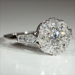 This gorgeous Art Deco diamond, platinum and 18k gold engagement ring was made in England during the 1930's. 1.1ctw