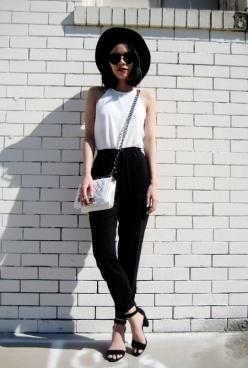 White halter neck tucked into black leather leggings and a bowl hat. So chic!