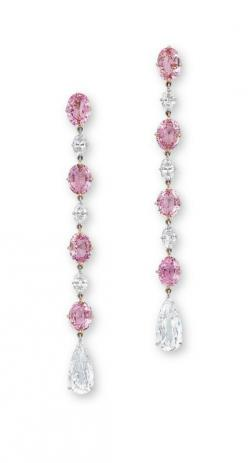 A PAIR OF PADPARADSCHA SAPPHIRE AND DIAMOND EAR PENDANTS  Each set with a line of oval-shaped padparadscha sapphires weighing approximately 1.58 to 1.26 carats, alternating with oval-shaped diamonds, terminating in pear-shaped diamonds, mounted in 18k ros