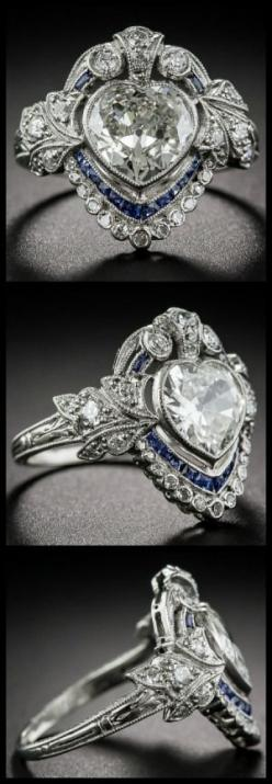 All views of an antique sapphire and diamond ring with a 1.20 carat heart shaped center diamond. At Lang Antiques.