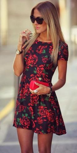I love this black dress with the red roses and a red clutch to match. Day time! @lesliemelton1