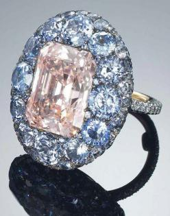 JAR: A UNIQUE COLOURED DIAMOND, SAPPHIRE AND DIAMOND RING. Sold at auction by Christie's Hong Kong November 2012.  A 8.59 carat cut-cornered rectangular cut fancy pink diamond surrounded by sapphires.