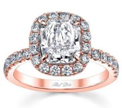 Rose gold engagement ring with u pave band and diamond halo.  This ring from DeBebians.com is from the exclusive Bel Dia Collection and features a cushion cut center diamond.