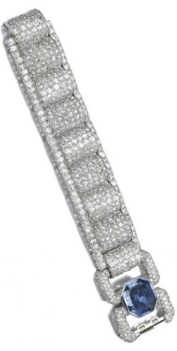 SAPPHIRE AND DIAMOND BRACELET, 1930S Designed as a series of arched links set with circular- and rose-cut diamonds between borders of circular-cut stones, the clasp collet-set with a foiled back octagonal mixed-cut sapphire, mounted in platinum and gold,