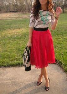 Love the pleated skirt, with a thin striped shirt and the large turquoise necklace.