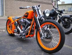 Bright orange Harley Davidson.    OEM Harley Replacement Batteries that are made in the USA--like your Harley.  www.throttlexbatteries.com: