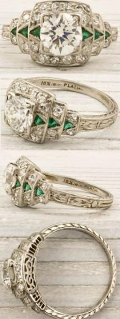 Art Deco engagement ring, circa 1925. Featuring a .79 carat (approx) EGL certified old European cut diamond with F-G color and VS1 clarity. The center stone is accentuated by a row of triangle cut emerald arrows on ether side, and single cut diamonds all