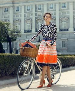 Love it. But, seriously, I would crack up if I saw a woman ACTUALLY riding a bike in those pumps & that longish and delicate skirt!
