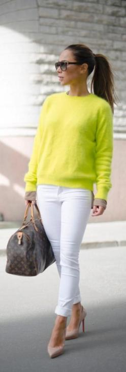 Fabulous electric lime bright sweater with white casual cute jeans and brown leather cute hand bag and pink high heels ladies pumps