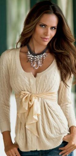 what a great way to give a cardigan shape. sew a ribbon on and tie a bow in front.