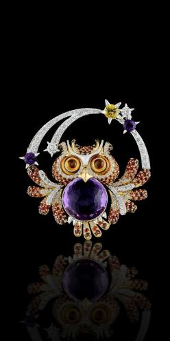 18К yellow and white gold, amethyst ct, diamonds, cognac diamonds, colored sapphires, amethysts.