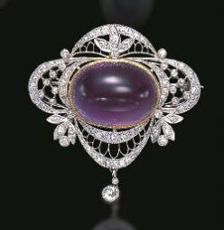 A BELLE EPOQUE AMETHYST AND DIAMOND BROOCH The circular-cut amethyst within the diamond garland surround, suspending a graduated fringe of diamond leaves to the three pear-shaped drops, millegrain setting, mounted in platinum and gold, circa 1900, 6.9 cm.