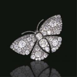 AN EXQUISITE ANTIQUE DIAMOND BUTTERFLY BROOCH  The old mine, old European and pear-shaped diamond body set en tremblant, extending similarly-set diamond wings, and single-cut diamond antennae, mounted in silver and gold, (with concealed hoop for suspensio